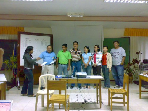 The FMC members distribute Certificate of Participation to workshop participants