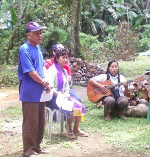 The PCFMPC Chair (standing), Rev. Fe (setting) and CDF Janelyn (playing guitar) during the launching